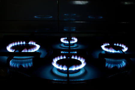 hobs: Blue Gas Stove Flames of multiple hobs, dark background Stock Photo