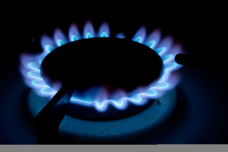 Blue Gas Stove Flames of multiple hobs, dark background Stock Photo