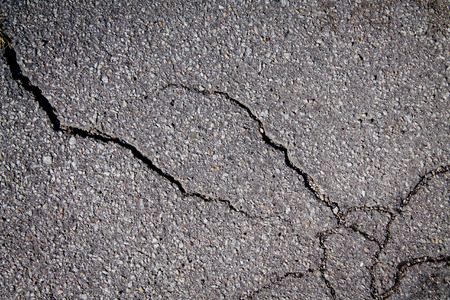 fissure: Fissure in asphalt Stock Photo