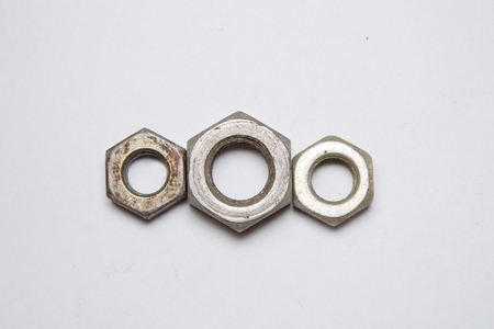 bolts and nuts: hex nuts on white background Stock Photo