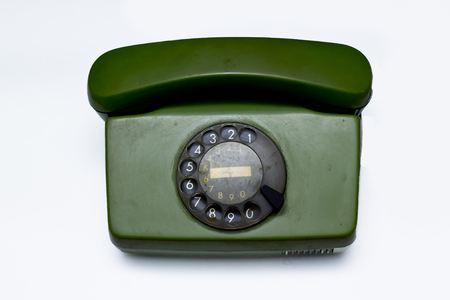 old green telephone on white background