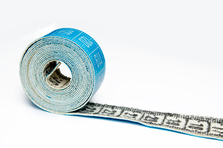 measure tape closeup on white background Foto de archivo