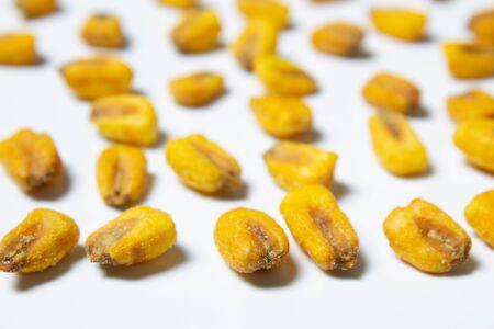 Roasted corn nuts on white background