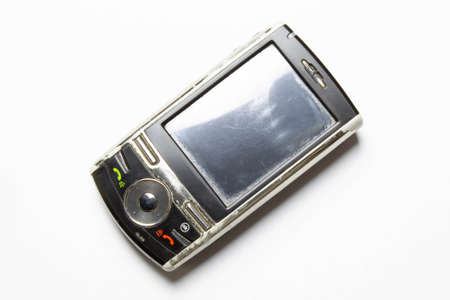 Old cell phone on white background