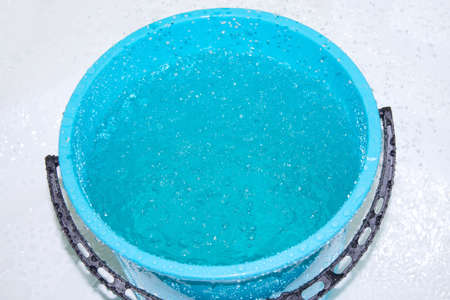 Blue bucket filled with water