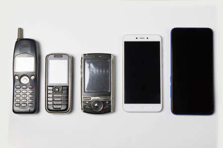 Evolution of cell phones on white background