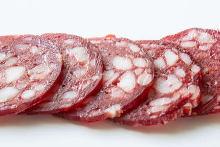 Slices of smoked sausage close up on white background 版權商用圖片