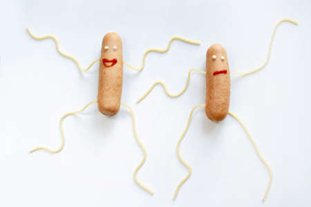 Creative food. Dancing sausages close up on white background
