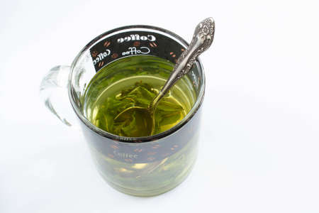 Tea with mint in a glass cup on white background 版權商用圖片