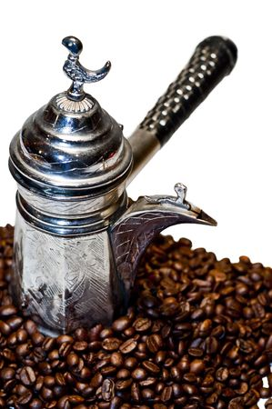 Isolated turkish Coffee pot with beans on white background photo