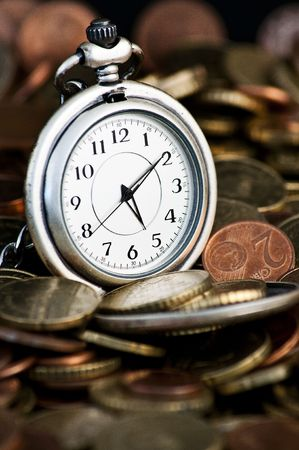 timely: Time is money concept with clock and coins