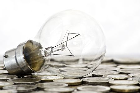 filament bulb lying on euro coins photo