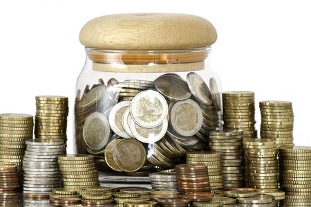 A jar full of coins on white background photo