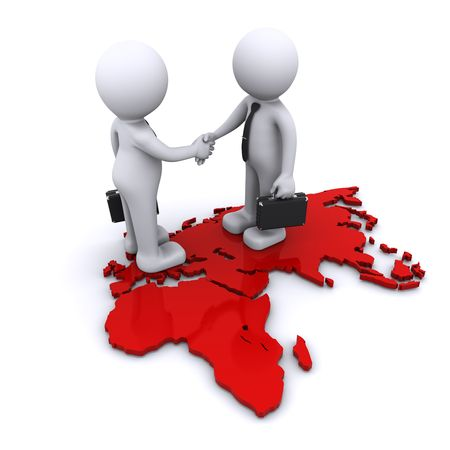 co operation: two businesmen standding on world map