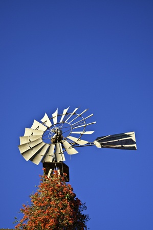 Wind mill against a blue sky photo
