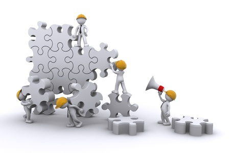 develop: business team work building a puzzle. Business developing concept. Isolated Stock Photo