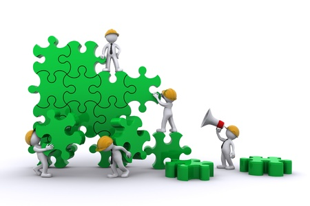 Business team work building a puzzle. Buuilding business concept. Isolated photo
