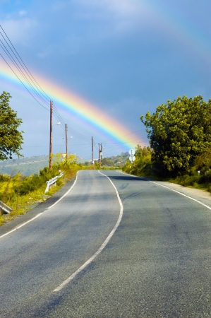 View at the beautiful rainbow above the road photo