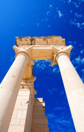 Columns of The Sanctuary of Apollo Hylates opposite blue sky - main religious centres of ancient Cyprus and one of the most popular tourist place photo