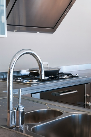 cookware: Water tap and sink in a modern kitchen interior