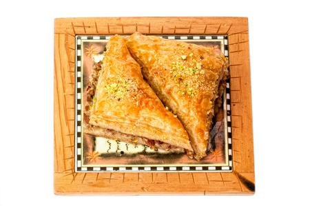 Baklava, traditional middle east sweet. Isolated on white photo