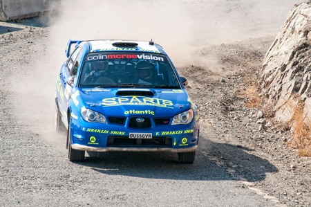 sponsors: LIMASSOL, CYPRUS - NOVEMBER 7: Driver Yiangou Yiangos and co-driver Christophi Leonidas driving Subaru Impreza STi during Rally Cyprus event at Love Cyprus Golden Stage on November 7, 2010 in Limassol, Cyprus.