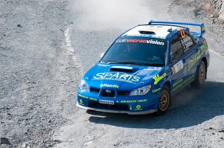 sponsors: LIMASSOL, CYPRUS - NOVEMBER 7: Driver Eraklis Velissariou (cy) and co-driver Evangelos Xenophontos (cy) Driving Subaru Impreza STi during Rally Cyprus event at Love Cyprus Golden Stage on November 7, 2010 in Limassol, Cyprus.  Editorial