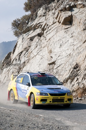LIMASSOL, CYPRUS - NOVEMBER 7: Driver Charalambos Timotheu (cy) and co-driver Pambos Laos (cy) driving Mitsubishi Lancer Evo X during Rally Cyprus event at Love Cyprus Golden Stage on November 7, 2010 in Limassol, Cyprus.