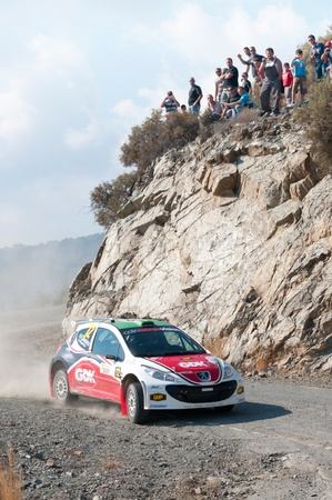 br: LIMASSOL, CYPRUS - NOVEMBER 7: Driver Daniel Rolin Oliveira (br) and co-driver Carlos Magahaeles (p) driving Peugeot 207 S2000 during Rally Cyprus event at Love Cyprus Golden Stage on November 7, 2010 in Limassol, Cyprus.