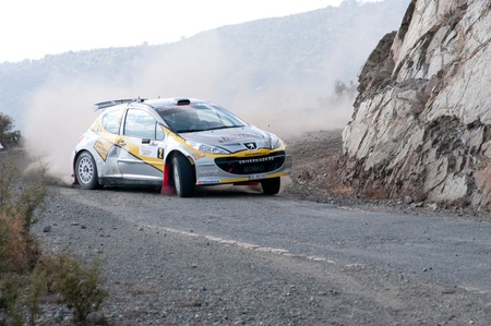 rally car: LIMASSOL, CYPRUS - NOVEMBER 7: Driver Bryan Bouffier (f) and co-driver Xavier Panseri (f) driving Peugeot 207 S2000 During Rally Cyprus event at Love Cyprus Golden Stage on November 7, 2010 in Limassol, Cyprus.  Editorial