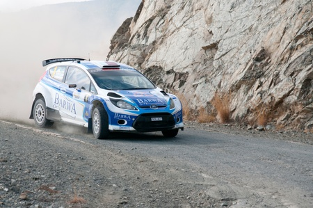 sponsors: LIMASSOL, CYPRUS - NOVEMBER 7: Driver Nasser Al-Attiyah (qa) and co-driver Giovanni Bernacchini (i) driving Ford Fiesta S2000 During Rally Cyprus event at Love Cyprus Golden Stage on November 7, 2010 in Limassol, Cyprus.  Editorial