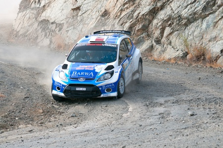 rally car: LIMASSOL, CYPRUS - NOVEMBER 7: Driver Nasser Al-Attiyah (qa) and co-driver Giovanni Bernacchini (i) driving Ford Fiesta S2000 During Rally Cyprus event at Love Cyprus Golden Stage on November 7, 2010 in Limassol, Cyprus.  Editorial