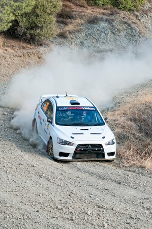 LIMASSOL, CYPRUS - NOVEMBER 7: Driver Gregoris Aspris (cy) and co-driver Neophytos Neophytou (cy) driving Mitsubishi Lander Evo X During Rally Cyprus event at Love Cyprus Golden Stage on November 7, 2010 in Limassol, Cyprus.