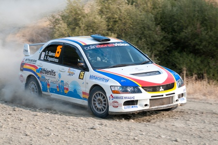 LIMASSOL, CYPRUS - NOVEMBER 7: Driver Savva Savvas (cy) and co-driver Andreas Papandreou (cy) driving Mitsubishi Lancer Evo IX during Rally Cyprus event at Love Cyprus Golden Stage on November 7, 2010 in Limassol, Cyprus.