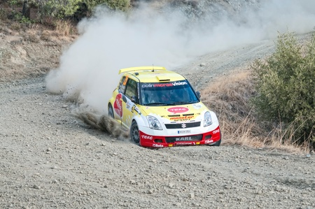 ee: LIMASSOL, CYPRUS - NOVEMBER 7: Driver Karl Kruuda (ee) and co-driver Martin Jarveoja (ee) driving Suzuki Swift  S1600 IX during Rally Cyprus event at Love Cyprus Golden Stage on November 7, 2010 in Limassol, Cyprus.  Editorial