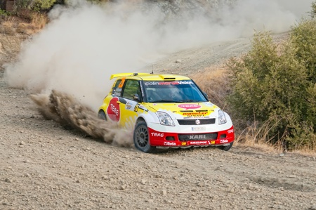 irc: LIMASSOL, CYPRUS - NOVEMBER 7: Driver Karl Kruuda (ee) and co-driver Martin Jarveoja (ee) driving Suzuki Swift  S1600 IX during Rally Cyprus event at Love Cyprus Golden Stage on November 7, 2010 in Limassol, Cyprus.  Editorial