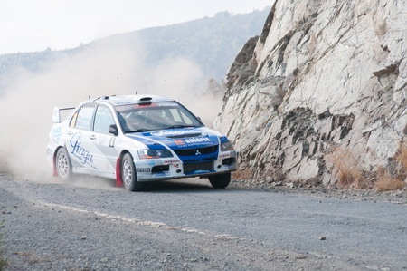 cz: LIMASSOL, CYPRUS - NOVEMBER 7: Driver Roman Kresta (cz) and co-driver Petr Gross (cz) driving Mitsubishi Lancer Evo IX during Rally Cyprus event at Love Cyprus Golden Stage on November 7, 2010 in Limassol, Cyprus.  Editorial