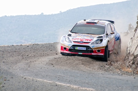 sponsors: LIMASSOL, CYPRUS - NOVEMBER 7: Driver Martin Prokop (cz) and co-driver Jan Tonamek (cz) driving Ford Fiesta S2000 During Rally Cyprus event at Love Cyprus Golden Stage on November 7, 2010 in Limassol, Cyprus.  Editorial