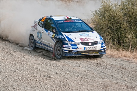 LIMASSOL, CYPRUS - NOVEMBER 7: Driver Janos Puscadi (h) and co-driver Zoltan Szechenyi (cy) driving Honda Civic Type R3 During Rally Cyprus event at Love Cyprus Golden Stage on November 7, 2010 in Limassol, Cyprus.