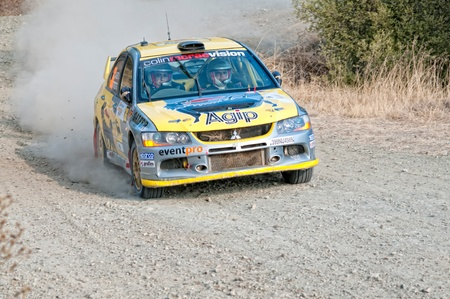 acceleration: LIMASSOL, CYPRUS - NOVEMBER 7: Driver Panayiotis Yiangou (cy) and co-driver Stavros Avgousti (cy) driving Mitsubishi Lancer Evo IX During Rally Cyprus event at Love Cyprus Golden Stage on November 7, 2010 in Limassol, Cyprus.