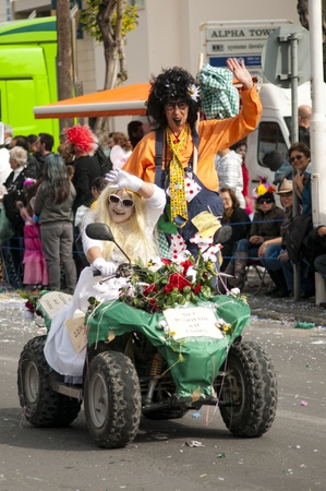 LIMASSOL, CYPRUS - MARCH 6: Just Married drives quadbike at Carnival Annual Parade on March 6, 2011 in Limassol, Cyprus.
