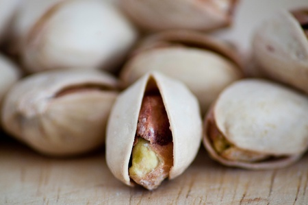 Salty nuts of roasted pistachio on an old wooden table. Stock Photo - 9989648
