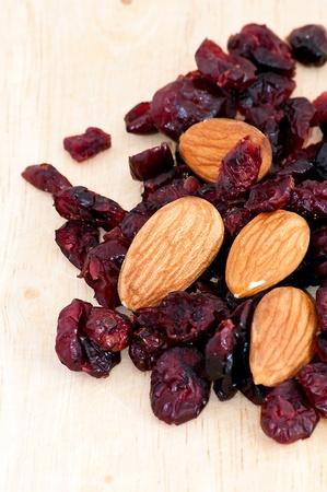 mix of raisinsand almond nut on old wooden table Stock Photo - 9989641