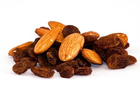 mix of raisinsand almond nut on isolated background Stock Photo - 9989634