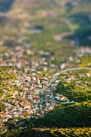 tilt: Aerial view of mountain village with tilt shift lens effect