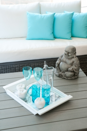 porch: Modern garden furniture with Buddha statue on the table