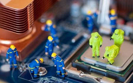 hazmat: Group of construction workers repairing motherboard Stock Photo