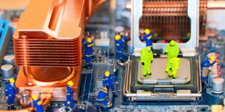 Team of construction workers repairing computer Stock Photo - 11272874
