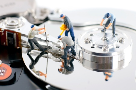 hdd: Group of workers repair hard drive. Hard drive repair concept Stock Photo