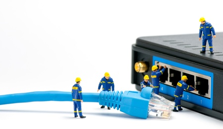 administrators: Technicians connecting network cable. Network connection concept